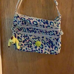 Kipling multi colored cheetah cross body bag.